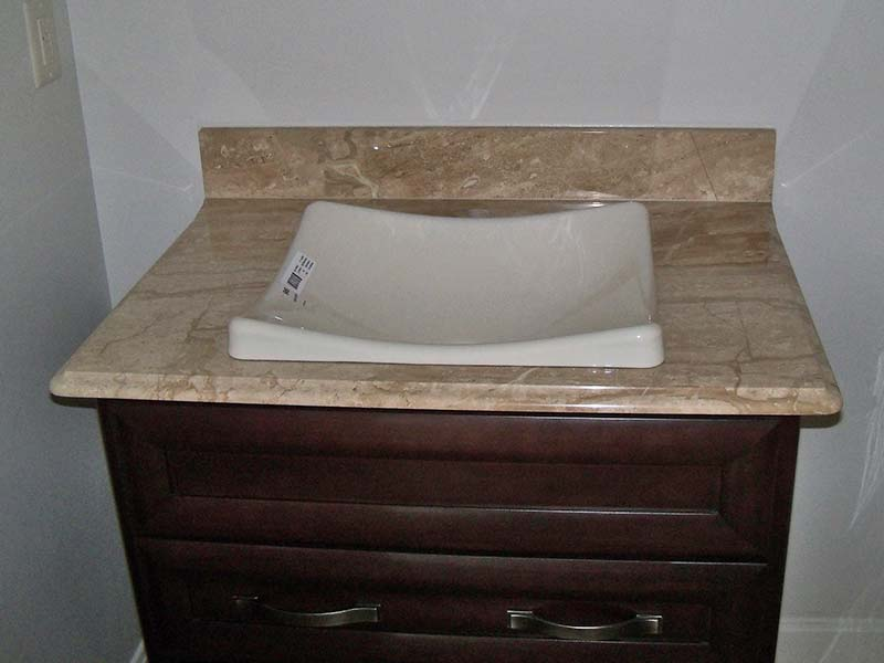 Daino Realle Marble bathroom counter with vessel sink