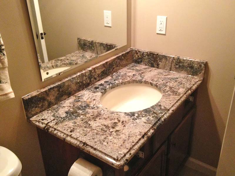 Diamond Wave Granite bathroom counter in a light earth tone bathroom.