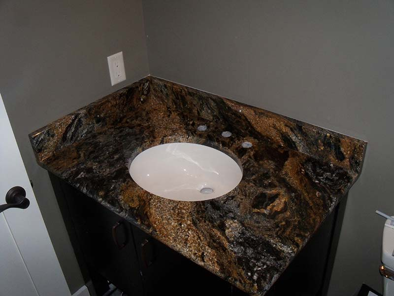 This Bathroom Counter Of Magma Granite Shows The High Contrast Colors Of  Gold, Dark Grey
