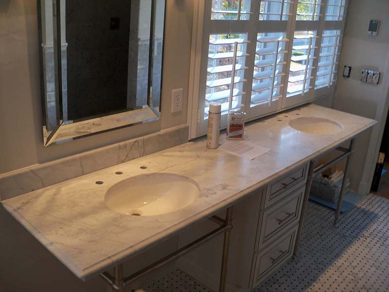 Honed Super White Marble bathroom counter with with double sink.