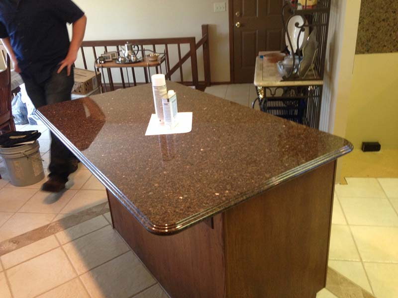Brown Pearl (Imperial Coffee) Granite kitchen island.