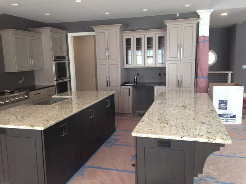 Polished Delicatus Granite on Expresso or Painted cabinets look great.