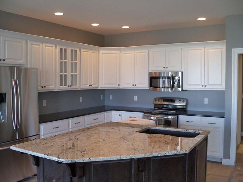 Delicatus Granite over dark wood is the spotlight of this kitchen.