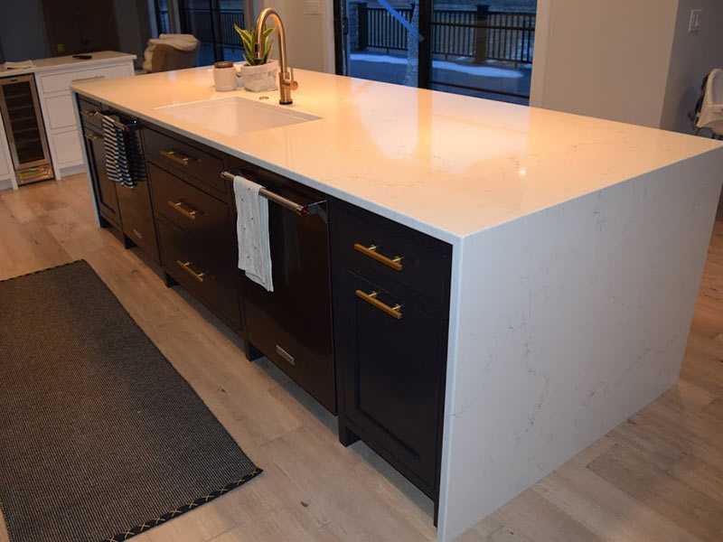 Misterio Vicostone Quartz:  White with Grey Vein with waterfall legs on island