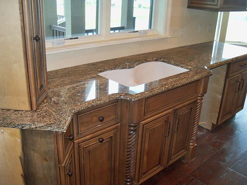 Stormy Night Granite with the custom double sink over ashen retro looking cabinets.