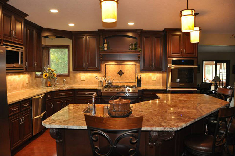 Typhoon Bordeaux Granite looking lovely against medium dark brown cabinets.