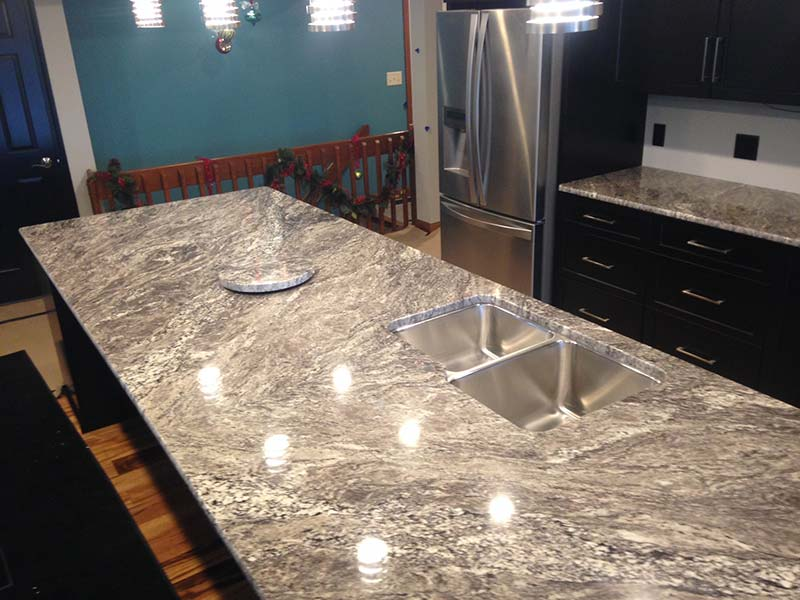 White Thunder Granite kitchen island and matching Lazy Susan.