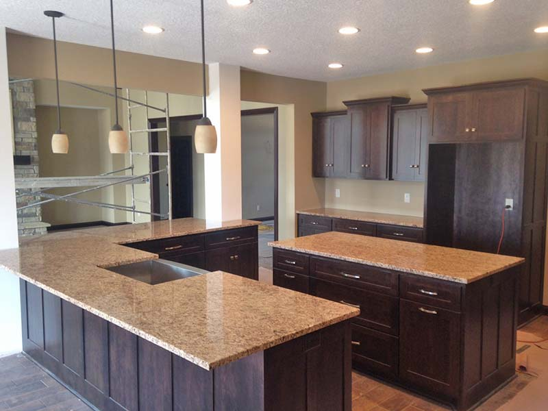 Giallo Ornamental Granite Kitchen Counters And Center Island Show Off This Large With Dark Wood